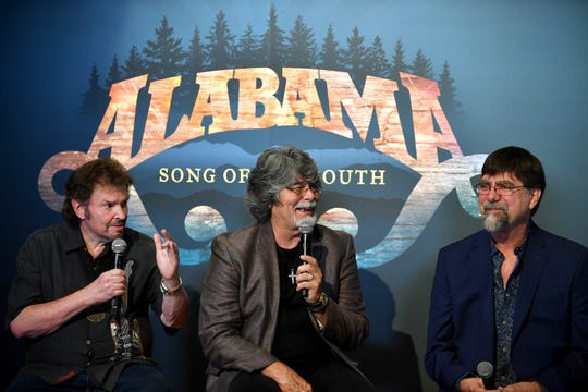 "Jeff Cook, Randy Owen and Teddy Gentry of country band Alabama speak during the debut of the ""Alabama: Song of the South"" exhibition at the Country Music Hall of Fame and Museum in 2016."