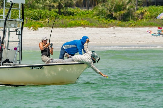 Sage Indendi battles a tarpon in the eighth annual 'Ding' Darling and Doc Ford's Tarpon Tournament.