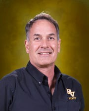 Mark Latell, Bishop Verot