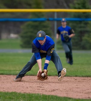 Oconto second baseman Trevor Bowman fields a hit by Kewaunee in Oconto on May 3, 2019, then threw the runner out at first.