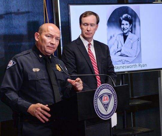 Greenville police Chief Ken Miller, left, talks near Thirteenth Circuit Solicitor Walt Wilkins, right, about an arrest in the 1988 cold case homicide of Alice Haynesworth Ryan, during a city police announcement in Greenville Monday. Police arrested suspect Brian Keith Munns.