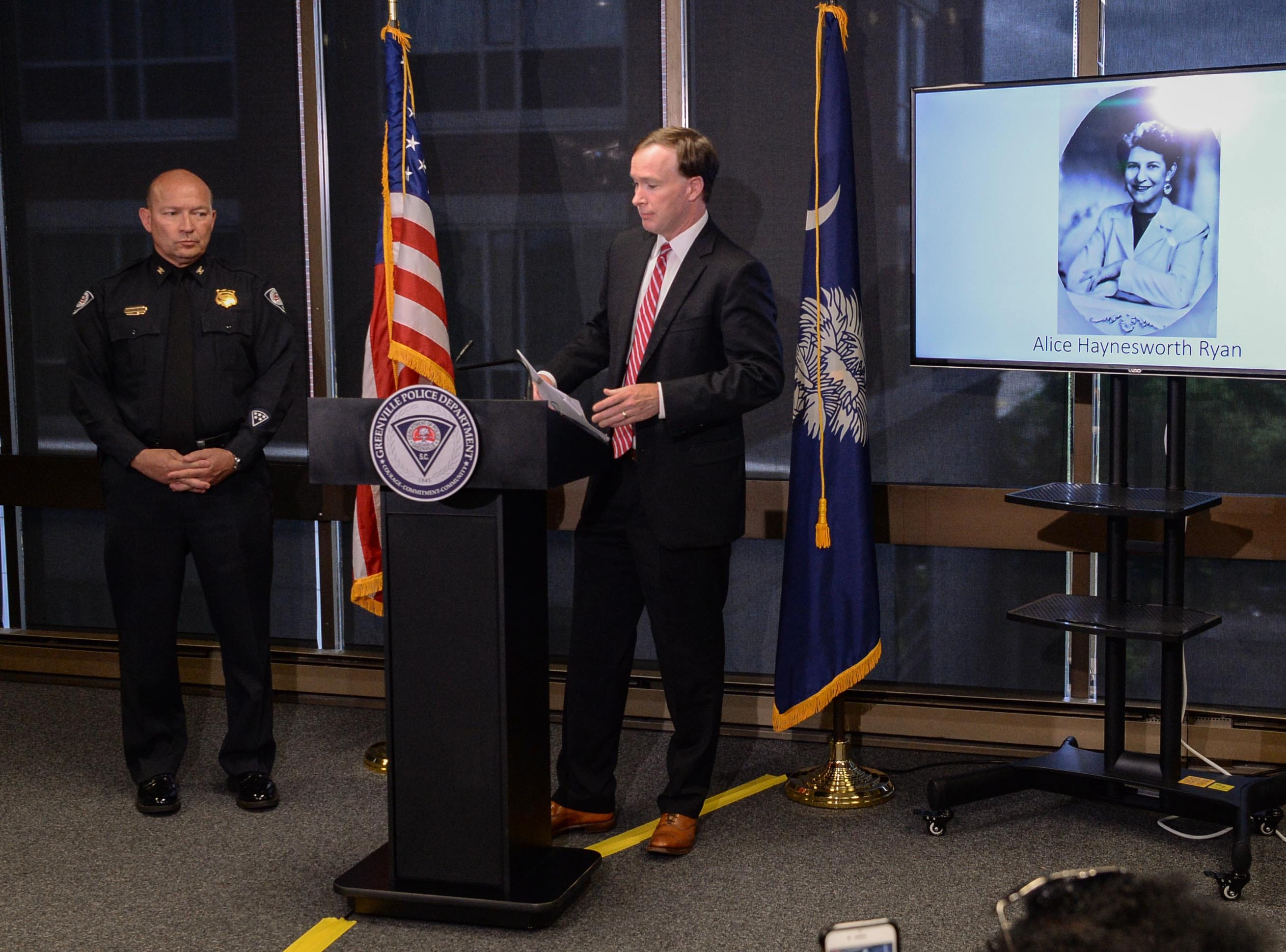 Greenville police Chief Ken Miller, left, stands near Thirteenth Circuit Solicitor Walt Wilkins talking about an arrest in the 1988 cold case homicide of Alice Haynesworth Ryan, during a city police announcement in Greenville Monday. Police arrested suspect Brian Keith Munns.