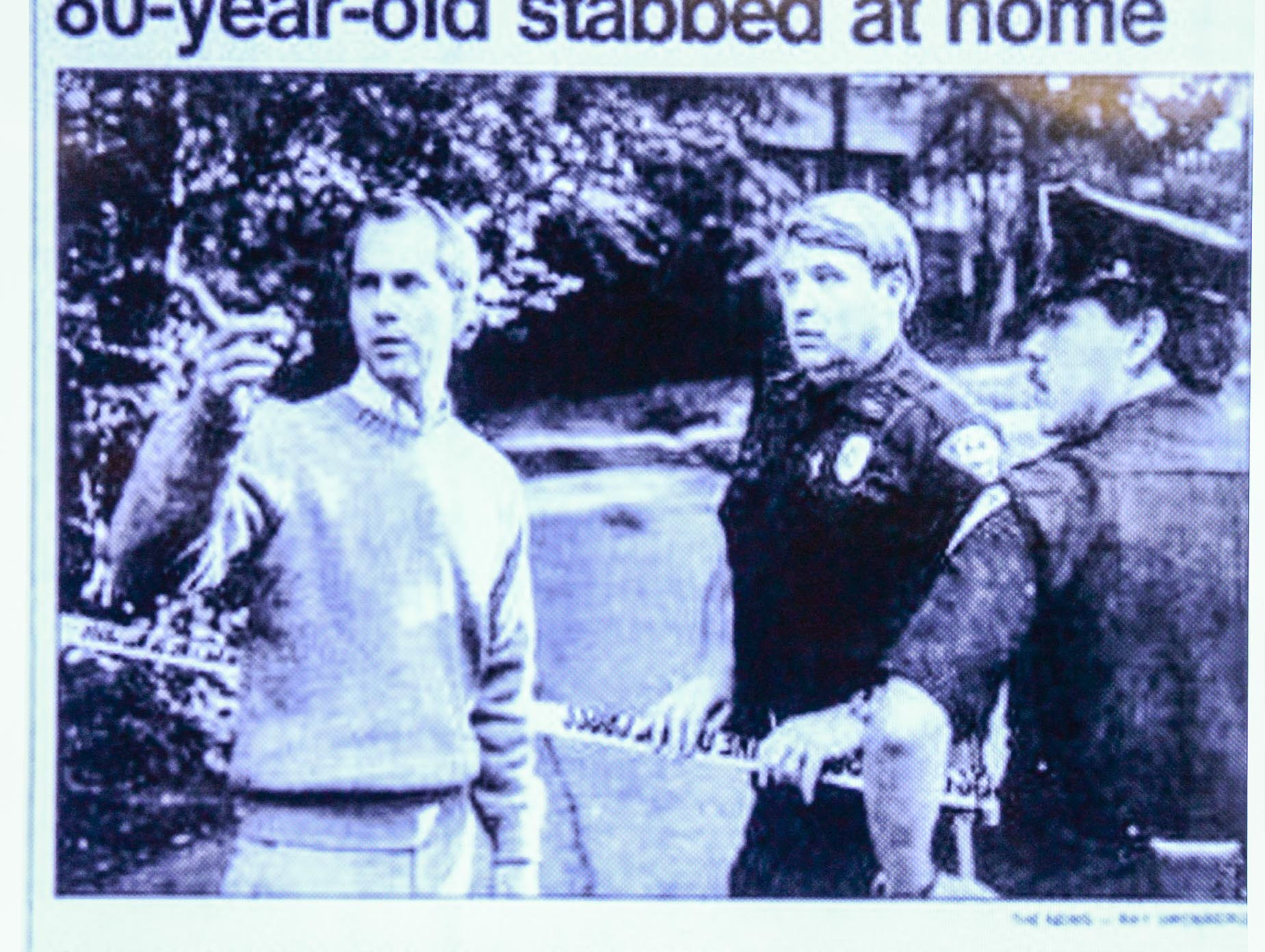 A 1988 Greenville News clipping of a photo from 1988 with then Lt. Don Belue, middle, at the scene where Alice Haynesworth Ryan was stabbed at home, shown on a screen during the announcement of an arrest Monday. Police arrested suspect Brian Keith Munns.
