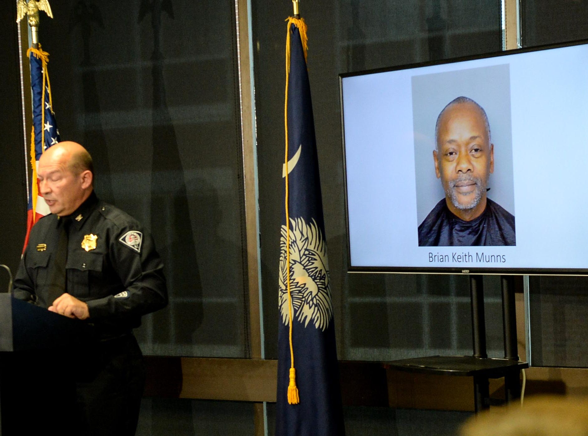 A Greenville police photo of arrested suspect Brian Keith Munns is displayed as police chief Ken Miller talks about an arrest in the 1988 cold case homicide of Alice Haynesworth Ryan, during the announcement at the city police department Monday.