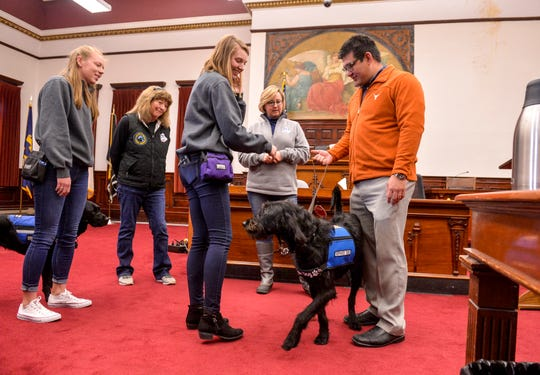 Military veteran Fernando Terrones meets his new service dog, Major, on Monday afternoon at the Cascade County Courthouse.  Terrones is a participant in Veterans Treatment Court with Judge Greg Pinksi and was accepted into a collaborative program between Carroll College's anthrozoology department and Dog Tag Buddies that will provide him with instruction on living with a service dog.