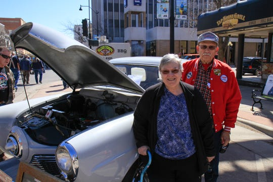 Mark Ferguson and his wife next to their 1951 Studebaker Champion