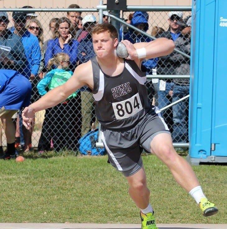 Sidney's Hughes looking for shot put in mid-60s