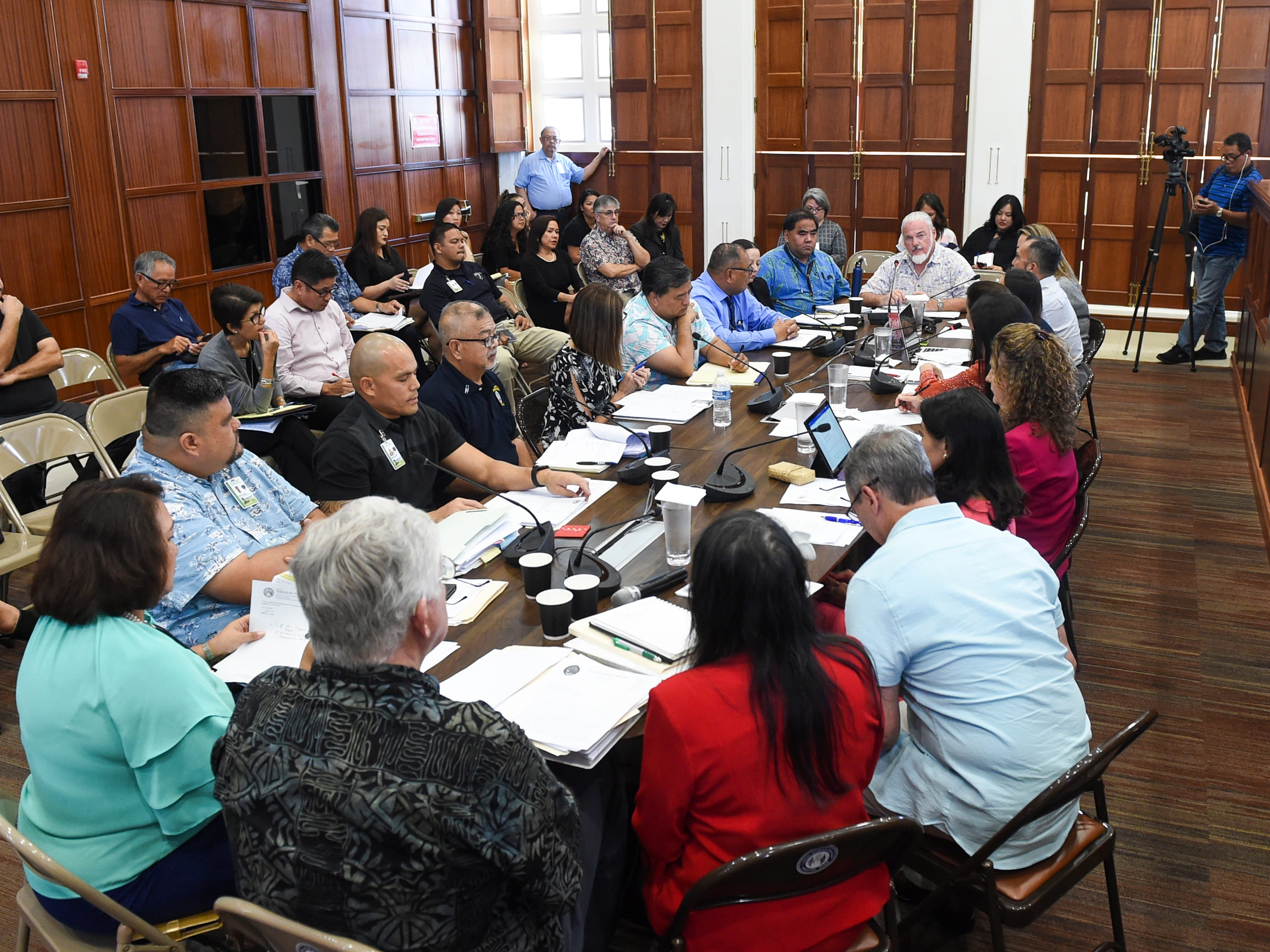Members of the 35th Guam Legislature meet with officials from the Judiciary, Attorney General, Public Defender, Parole Corrections, and Behaviorial Health agencies for a roundtable discussion at the Guam Congress Building in Hagåtña on May 6, 2019.