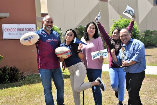 Mara Tamayo, a senior rugby standout for the Okkodo Bulldogs, accepted an academic and athletic scholarship to play Division I rugby for Mount St. Mary's. She is shown here, second from left, with her coach Tony Costa at far left, and her parents Stephanie and Marlon, and sister Ayva.