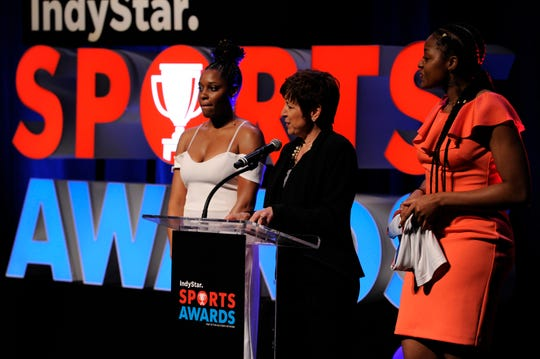 Miss Basketball 2011, Bria Goss, Dr. Allison Barber, President and Chief Operating Officer of the Indiana Fever and Miss Basketball 2013, Stephanie Mavunga announce the 2019 Indiana Miss Basketball during the Indiana Sports Awards at Clowes Hall on the campus of Butler University, Sunday, May 5, 2019.