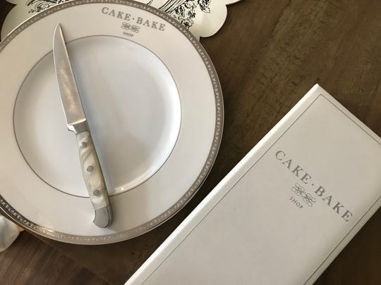 Silver-rimmed china and mother-of-pearl-handled knives set tables at Cake Bake Shop coming to Carmel City Center in 2019.