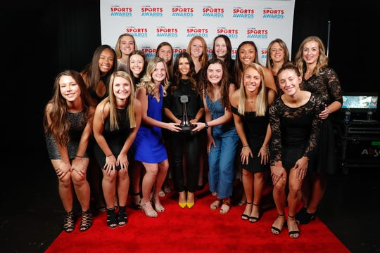 Team of the Year award winners, the Yorktown High School girls volleyball team is photographed with IndyCar driver Danica Patrick, at the IndyStar Sports Awards, held at Clowes Hall in Indianapolis on Sunday, May 5, 2019.