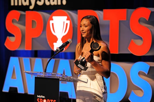 Kenzie Knuckles of Yorktown accepts the award for Girls Athlete of the Year during the Indiana Sports Awards at Clowes Hall on the campus of Butler University, Sunday, May 5, 2019.
