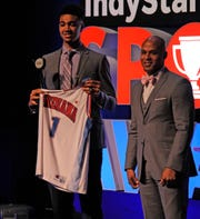 Trace Jackson-Davis of Center Grove accepts the 2019 Mr. Basketball award by former Indiana Pacer Eddie Gill during the Indiana Sports Awards at Clowes Hall on the campus of Butler University, Sunday, May 5, 2019.