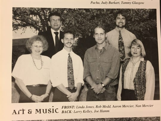 Larry Baker with other art and music staff in the 1995 West High School yearbook.
