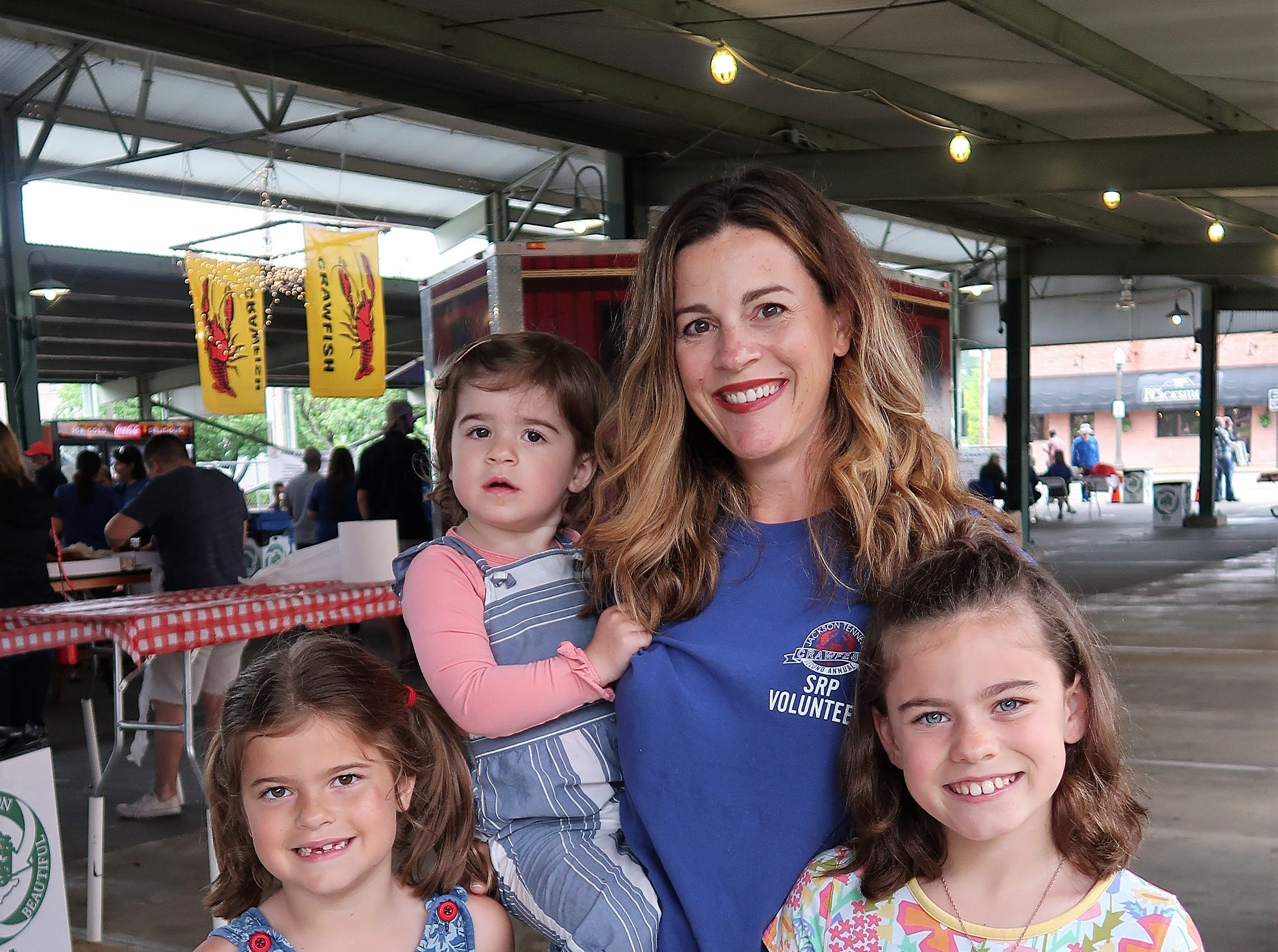 Milly Smith, Taylor May Smith, Sarah Smith and baby Stella Smith pose with a crawfish at the Second Annual Crawfest fundraiser for the Scarlet Rope Project at the West Tennessee Farmer's Market in Jackson on May 4, 2019.