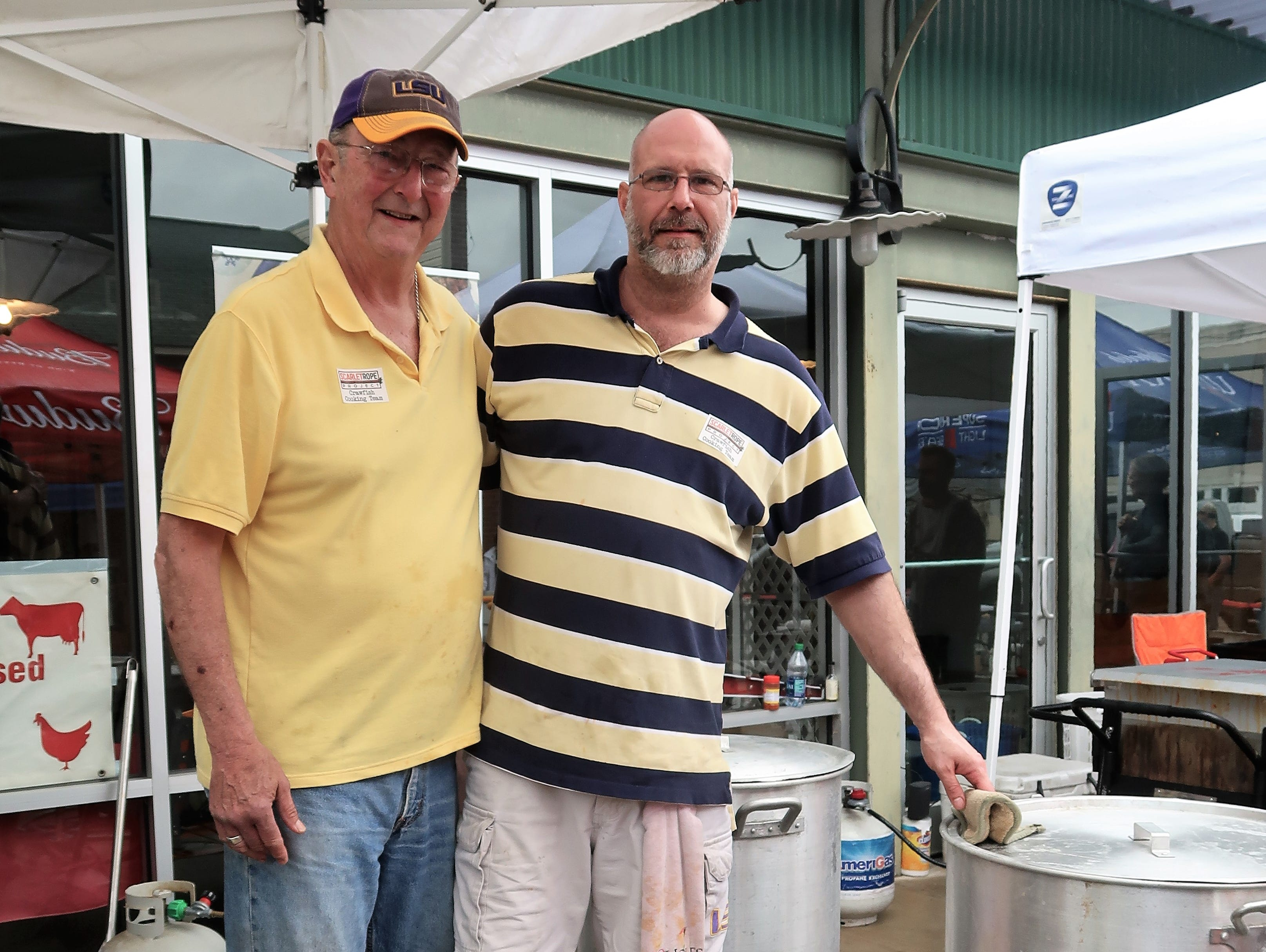 Jim Moss and Jimmy Moss pose at their crawfish boiling station at the Second Annual Crawfest fundraiser for the Scarlet Rope Project at the West Tennessee Farmer's Market in Jackson on May 4, 2019.