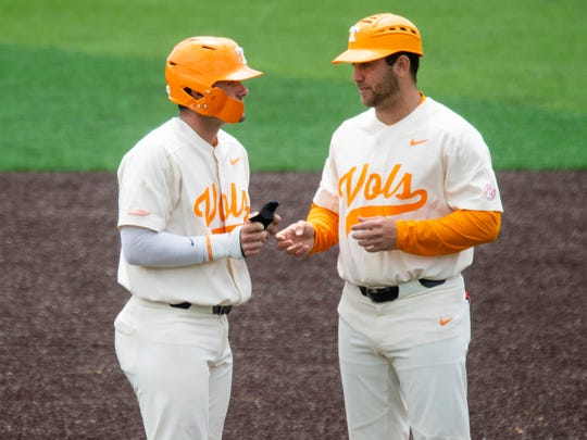 Tennessee volunteer assistant coach Ross Kivett, right, chats with Pete Derkay during a game against Missouri on May 5 at Lindsey Nelson Stadium. Among Kivett's duties is coaching first base during games.