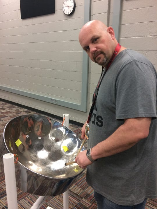 Band director Donnie Hero finds a beat on the steel drum.