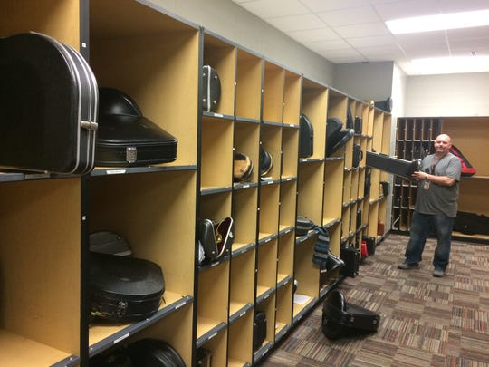 The instrument storage area gets a cleaning from Donnie Hero.