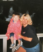 Brandon Breeden with his mother, Santina Breeden, in a photo taken in 2002. Brandon was four years old.