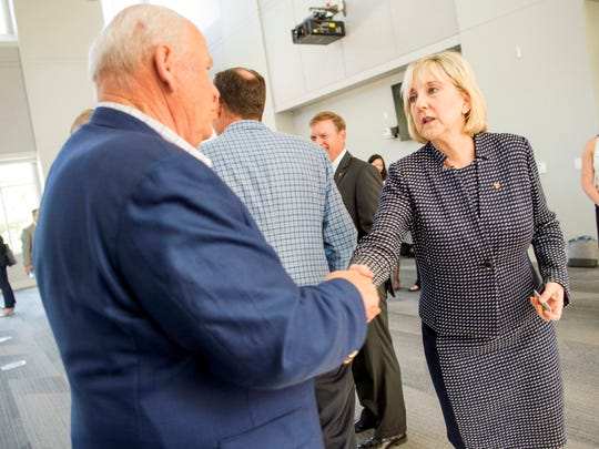 Donde Plowman, right, shakes hands with UT athletic director Phillip Fulmer, left, after a press conference introducing Plowman as chancellor of the University of Tennessee held at UT's Student Union on Monday, May 6, 2019.