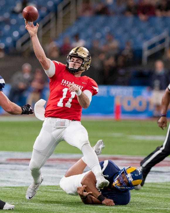 Jan 19, 2019; St. Petersburg, FL, USA; East quarterback David Blough (11) of Purdue looks to pass while being pressured by West defensive lineman Markus Jones (43) of Angelo State during the first quarter at Tropicana Field. Mandatory Credit: Douglas DeFelice-USA TODAY Sports