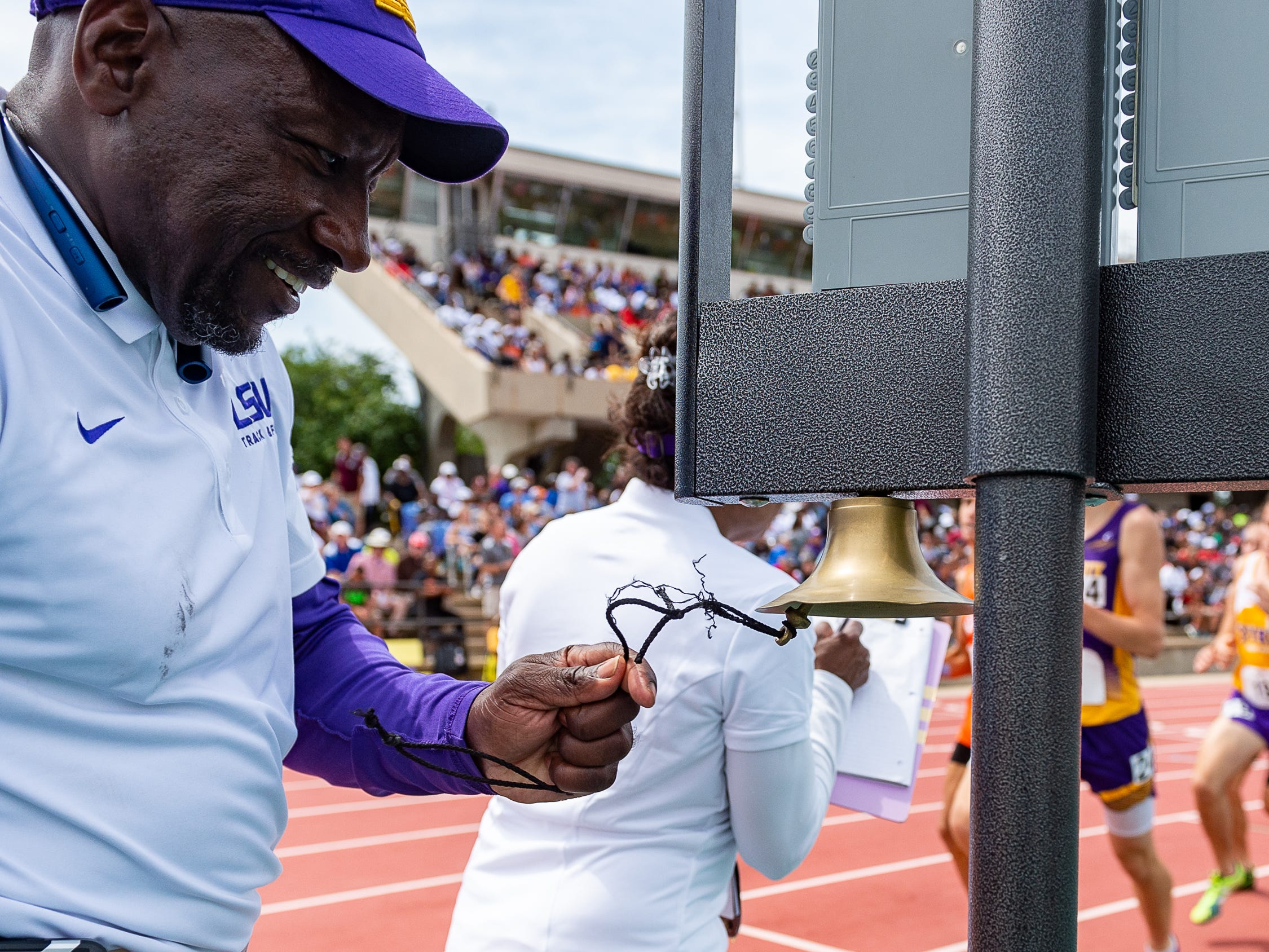 Track official rings bell to indicate the final lap of the boys 3200m run at The LHSAA Sate Track Meet at Bernie Moore Track in Baton Rouge, LA. Saturday, May 4, 2019.
