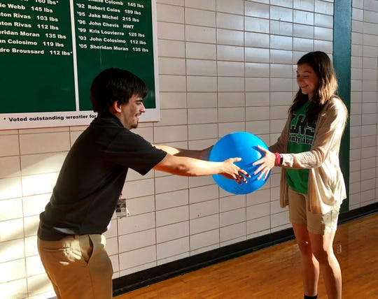 Brandon Thibodeaux and Julia Rhodes work together during a combined adapted physical education and peer support class at Lafayette High.