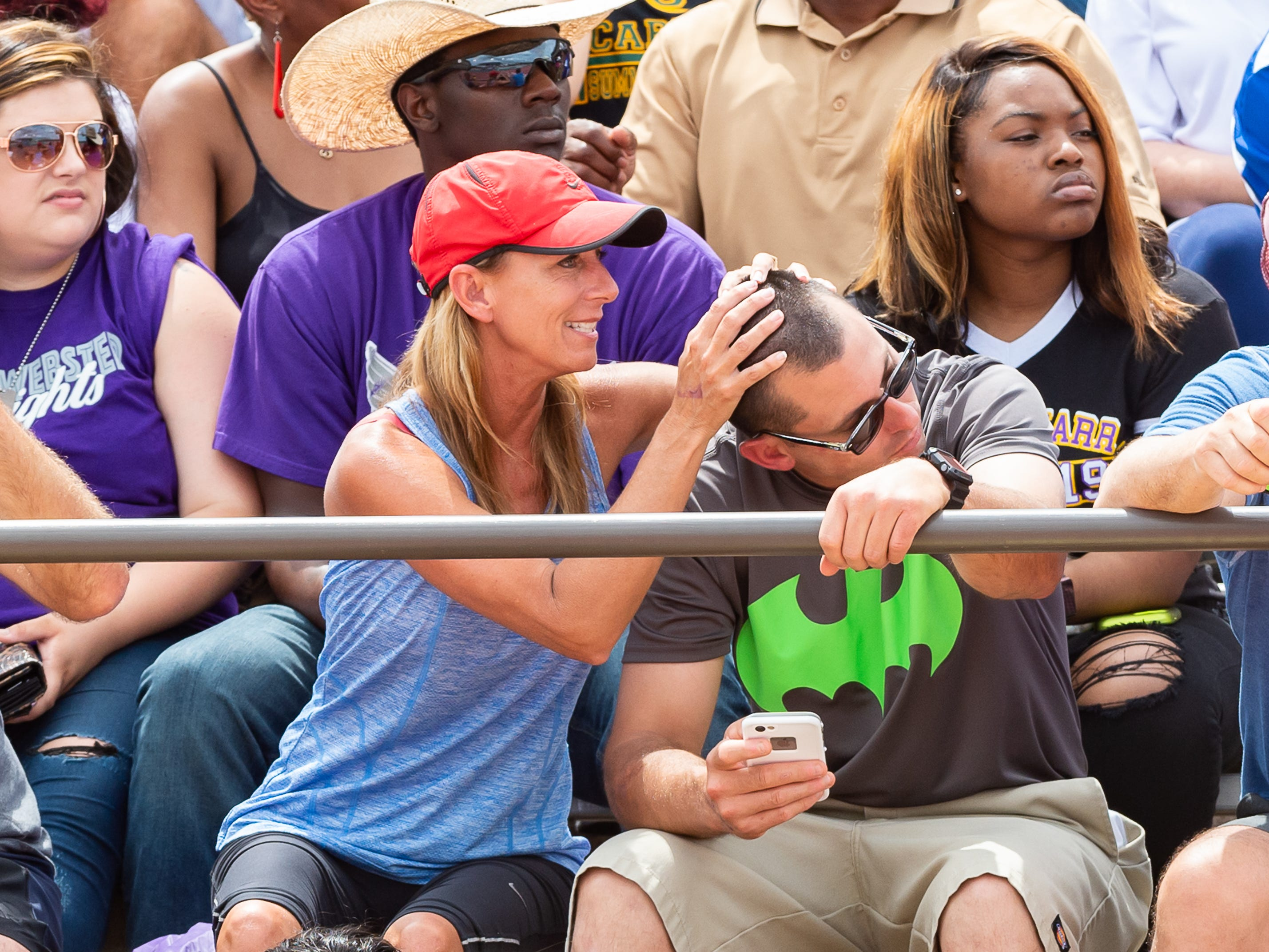 Bobbi Parker and her stepson Bill Parker cheering on Mia Parker to win the girls 3200m run at The LHSAA Sate Track Meet at Bernie Moore Track in Baton Rouge, LA. Saturday, May 4, 2019.