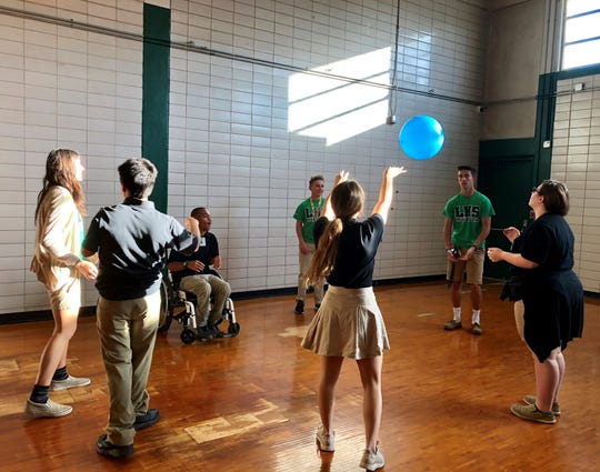 Lafayette High students in Courtney Vincent's adapted physical education and peer support classes play a ball game together May 6. Peer tutors are juniors and seniors who work directly with APE students every day.