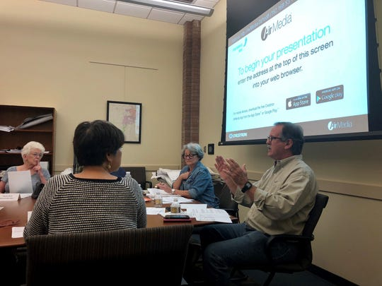 Andrew Duhon (far right), vice president of the Lafayette Public Library Board of Control, discusses potential funding scenarios during a special meeting May 6.