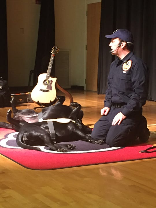 Trained Labradors Kasey and Kali play dead to demonstrate what can happen as a result of a house or building fire if occupants don't get out in time. The dogs were part of a Koorsen Fire & Security demonstration Monday at Liberty Union elementary and middle schools. Former Indianapolis firefighter/paramedic Jeff Ownes takes the dogs to 400 schools each year and gives the show to about 400,000 students annually.