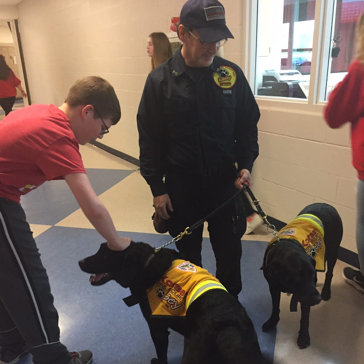 Liberty Union students learn about fire safety from trained dogs