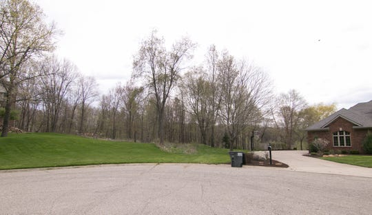 Side-by-side neighbors at the end of Hardun Road's cul-de-sac, shown Monday, May 6, 2019, are affected by proposed development beyond the cul-de-sac. A developer wants to build a road through the vacant lot to develop homes behind it on a wetland.