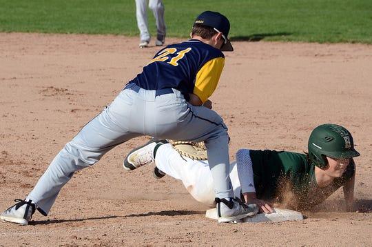 Hartland's Logan Tobel (21) hit two home runs against Holly.