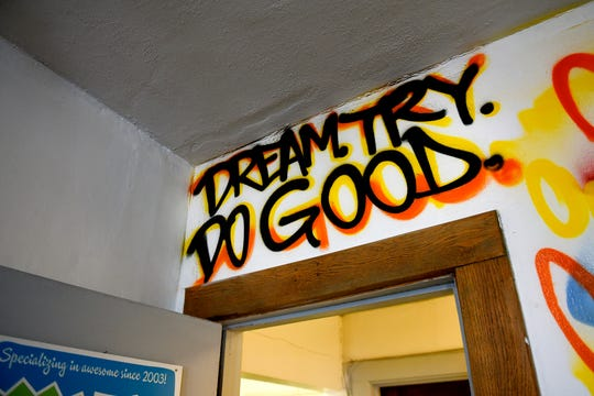 The quote 'Dream. Try. Do good.' from the TV show 'Boy Meets World' is written on the wall inside RetroDuck on Monday, May 6, 2019, in East Lansing. Owner Luke Hackney has always liked the quote by Mr. Feeny, one of the show's characters.