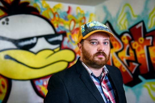 Luke Hackney, owner of RetroDuck, photographed in the business on Monday, May 6, 2019, in East Lansing. Hackney is heavily involved in the community through city boards.