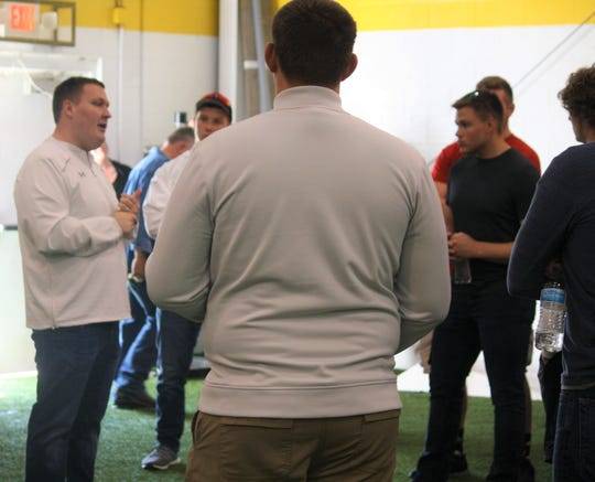 New Shelby High School football coach Rob Mahaney addresses the players on his North squad for the North Central Ohio Football Coaches Association All-Star Classic on Friday, June 14 at Lexington High School.