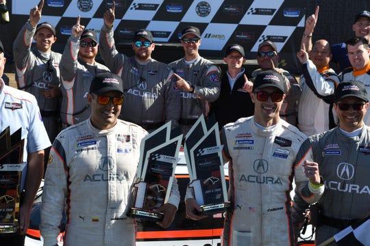 Team Penske's Juan Pablo Montoya, left, and Dane Cameron celebrate their Acura Sports Car Challenge at Mid-Ohio Championship on Sunday.