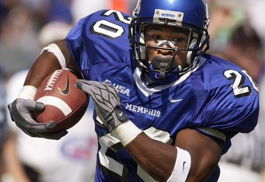 Memphis Tigers running back DeAngelo Williams carries the ball against Ole Miss in 2003.