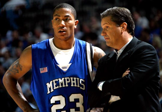Former Memphis basketball coach John Calipari, right, huddles up with former Tiger Derrick Rose in this 2007 file photo.