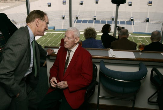 Bud Dudley, who founded the Liberty Bowl in 1959 and brought it to Memphis in 1965, talks with past Liberty Bowl president J.M. Gilliland in this 2005 file photo.
