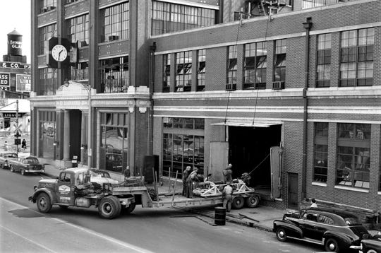 Foundation equipment for six new printing press units continued moving into the Memphis Publishing Co. at 495 Union on Mar. 1, 1955. A window was removed to permit entry of the material being built up from 13 feet below street level on which the new units will operate.