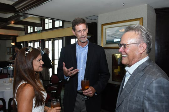 City Councilor Larry Honig, right, talks with finalist Michael McNees and his wife Hazel. The five finalists for the position of Marco Island City Manager met islanders during a meet and greet session at the Marco Island Yacht Club Sunday afternoon, May 5, 2019.