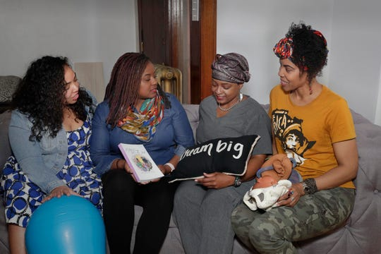 Doula Shani Toor (left), infant mental health consultant Kisha Shanks, and doulas Tiffany Scaife and Vanessa Johnson meet often as a community to encourage one another and share information. Doulas support, educate and advocate for mothers during the pregnancy and delivery process.