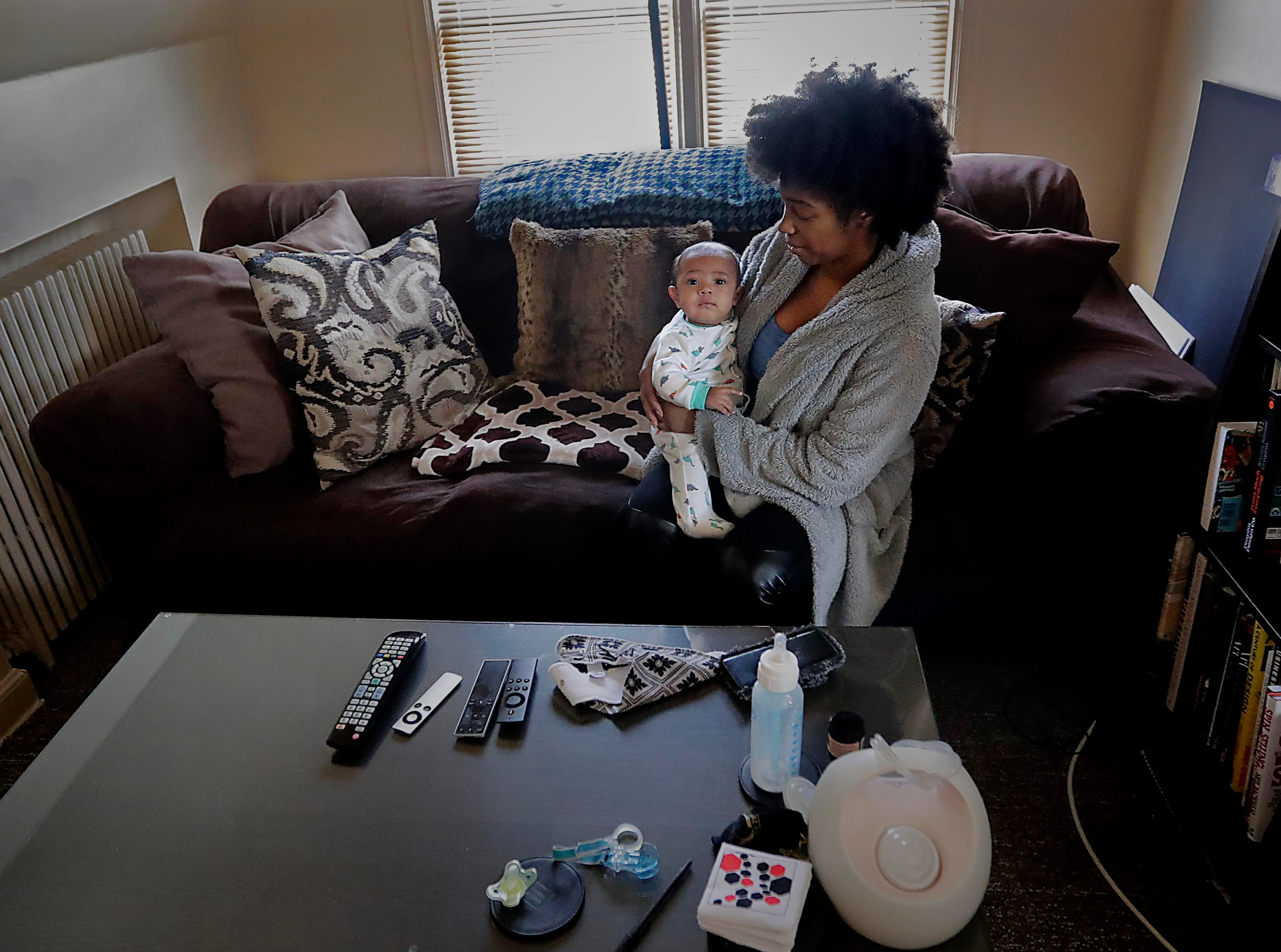 Natasha Lettner cares for her newborn son at her Milwaukee home. Lettner relied on Vanessa Johnson, her doula, for support, education and advocacy during pregnancy and the birthing process.