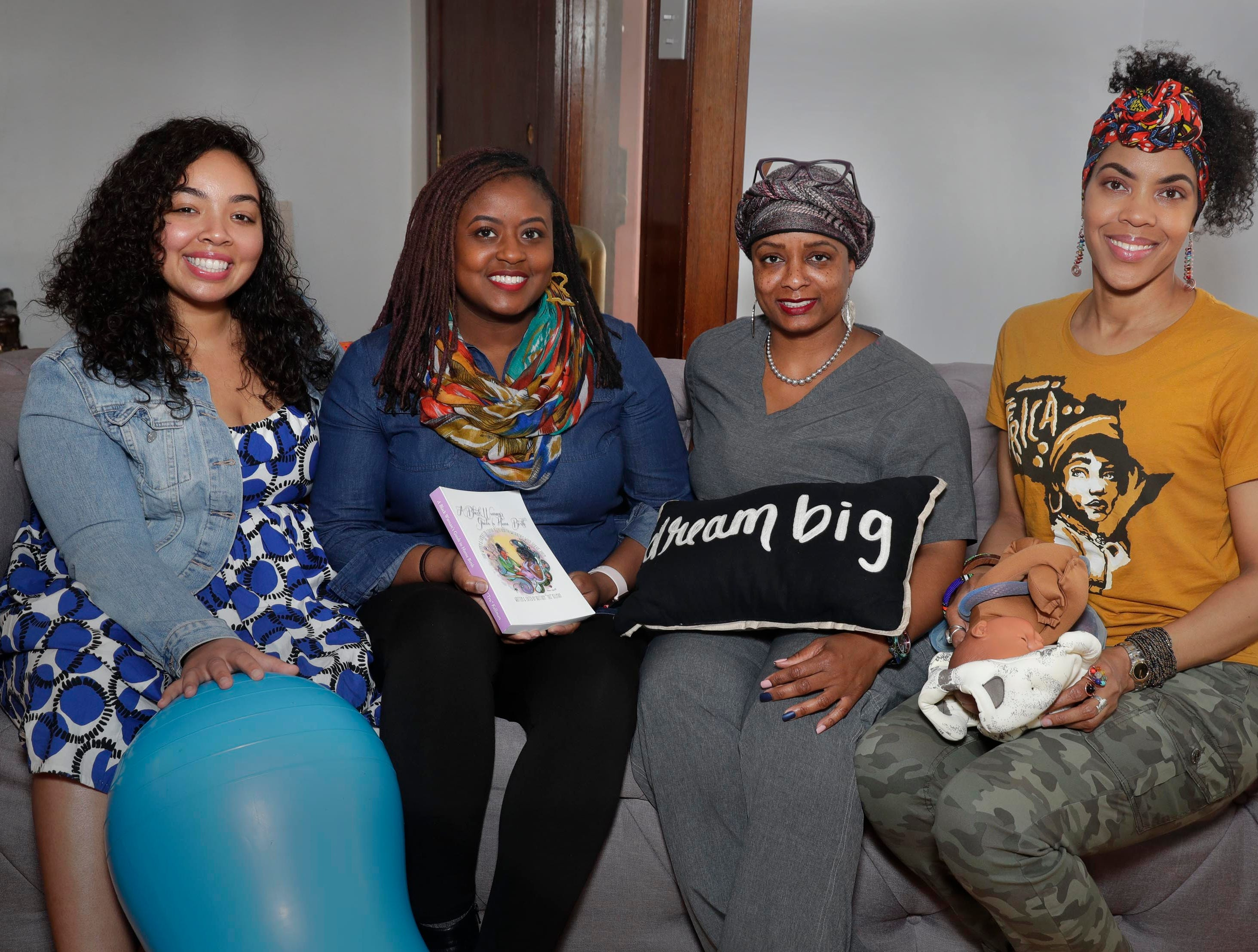 Doulas Shani Toor (left), infant mental health consultant Kisha Shanks, and doulas Tiffany Scaife and Vanessa Johnson meet often as a community to encourage one another and share information.