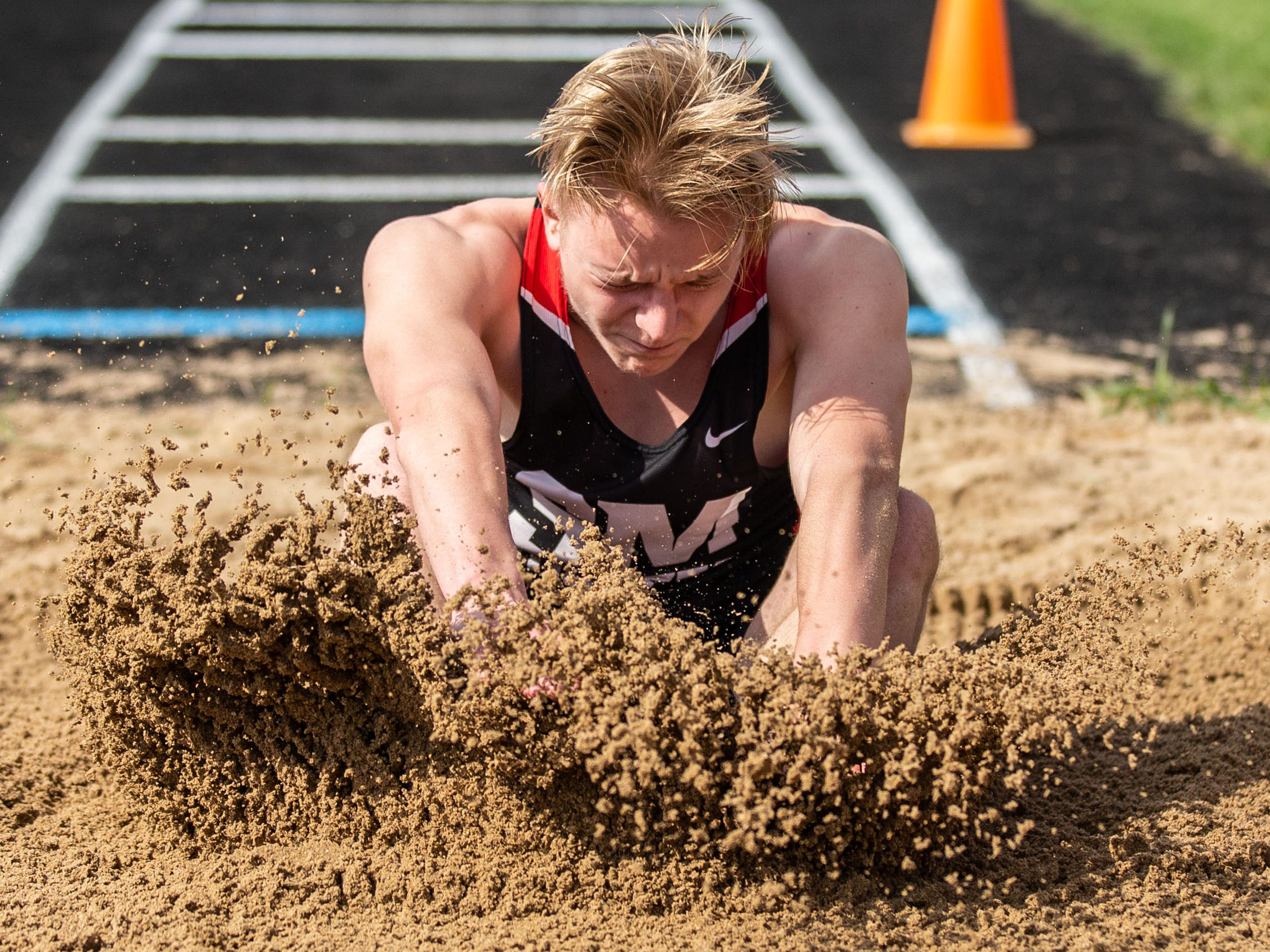 South Milwaukee junior Dylan Moll competes in the long jump at the 2019 Myrhum Invitational track and field meet in Hartland on Saturday, May 4.