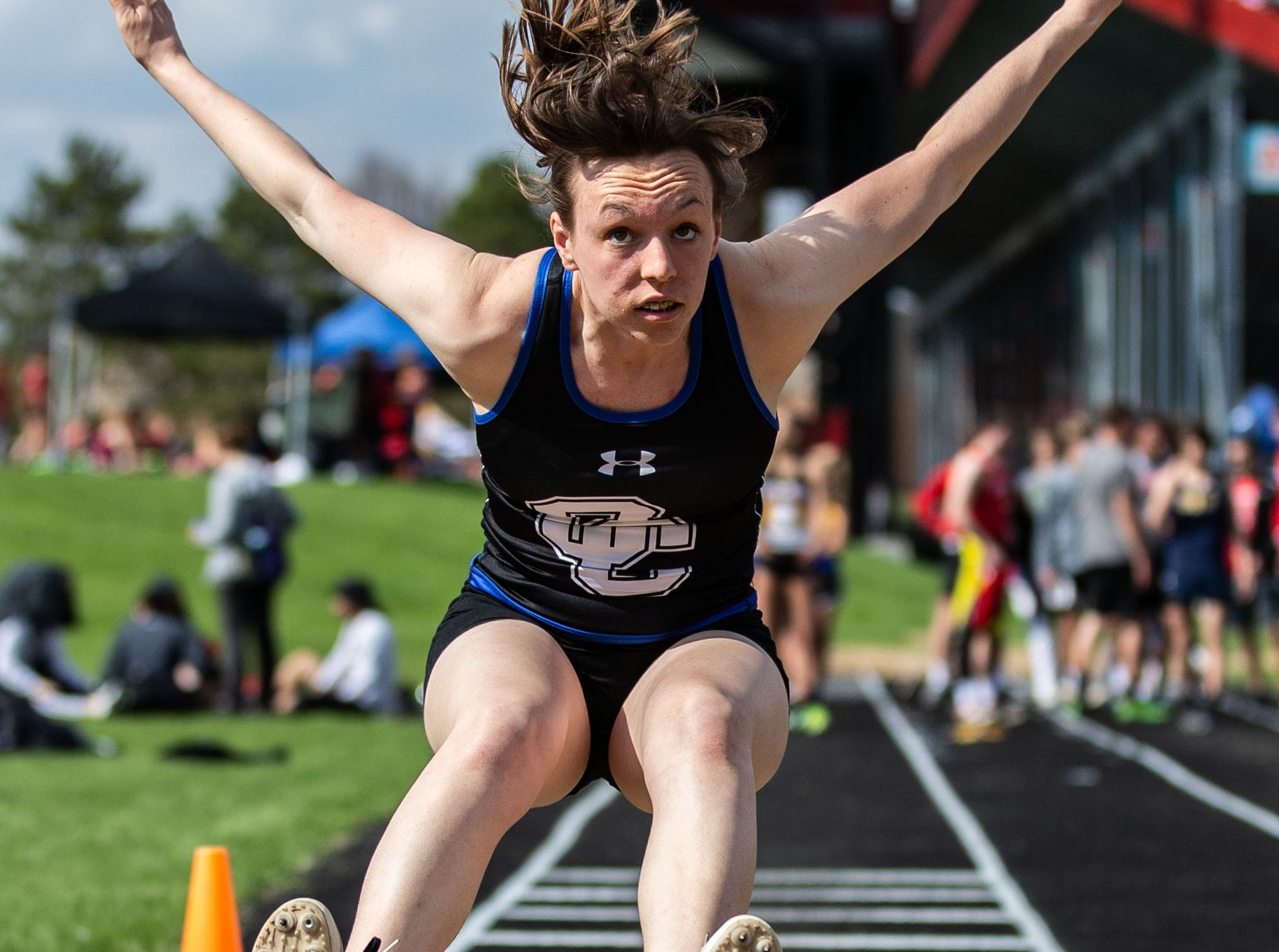 Oak Creek junior Carolyn Sladky competes in the long jump at the 2019 Myrhum Invitational track and field meet in Hartland on Saturday, May 4.